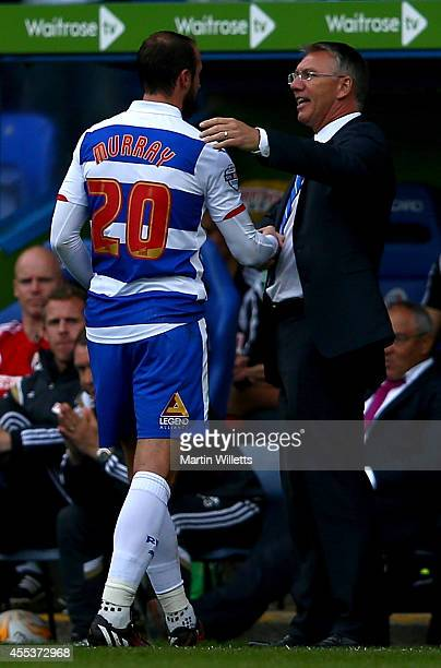 Nigel Adkins manager of Reading shakes hands with double goalscorer Glenn Murray after substituting him during the Sky Bet Championship match between...
