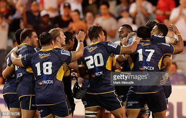 Nigel Ah Wong of the Brumbies celebrates scoring a try with team mates during the round two NRL match between the Brumbies and the Waratahs at GIO...