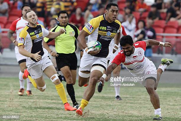 Nigel Ah Wong of The Brumbies charges forward during the World Club 10s match between The Brumbies and Biarritz Olympique at the National Stadium at...