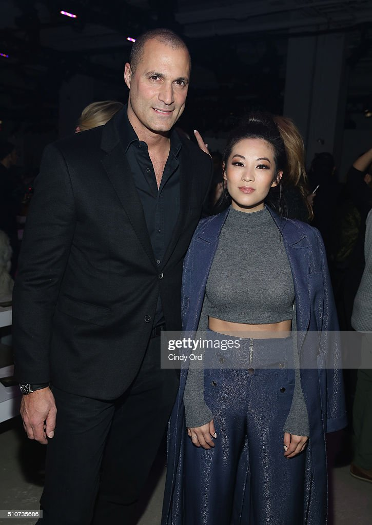 Nigel Barker (L) and Arden Cho attend the Georgine Fall 2016 fashion show during New York Fashion Week: The Shows at The Gallery, Skylight at Clarkson Sq on February 16, 2016 in New York City.