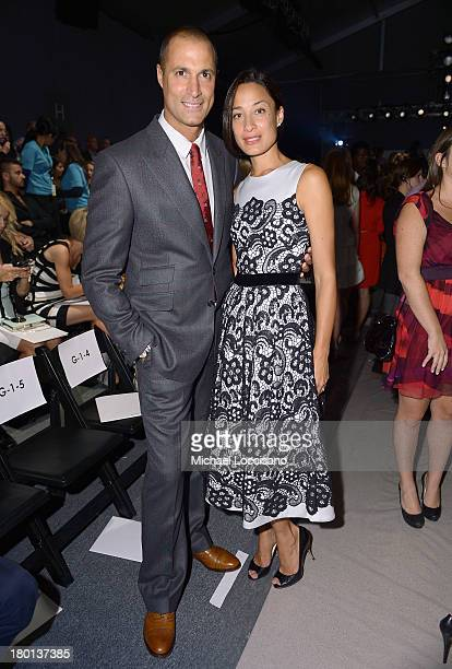 Nigel Barker and Crissy Barker attend the Pamella Roland fashion show during MercedesBenz Fashion Week Spring 2014 at The Studio at Lincoln Center on...