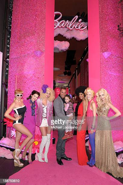 Nigel Barker and daughter Jasmine Ines Barke pose with models during Barbie The Dream Closet Playdate Saturday February 11th at David Rubenstein...