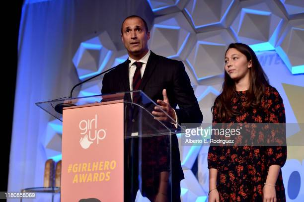 Nigel Barker and Jasmine Ines Barker speak onstage at the 2nd Annual Girl Up #GirlHero Awards at the Beverly Wilshire Four Seasons Hotel on October...