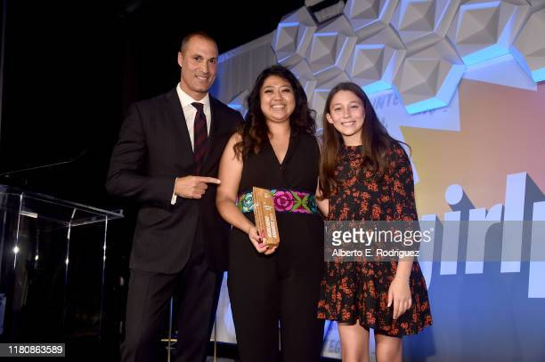 Nigel Barker Honoree Rocio Ortega and Jasmine Ines Barker pose onstage at the 2nd Annual Girl Up #GirlHero Awards at the Beverly Wilshire Four...