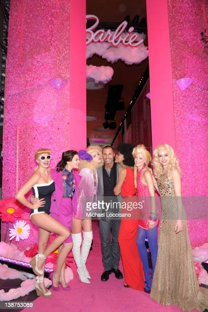 Nigel Barker poses with models during Barbie The Dream Closet Playdate Saturday February 11th at David Rubenstein Atrium on February 11 2012 in New...
