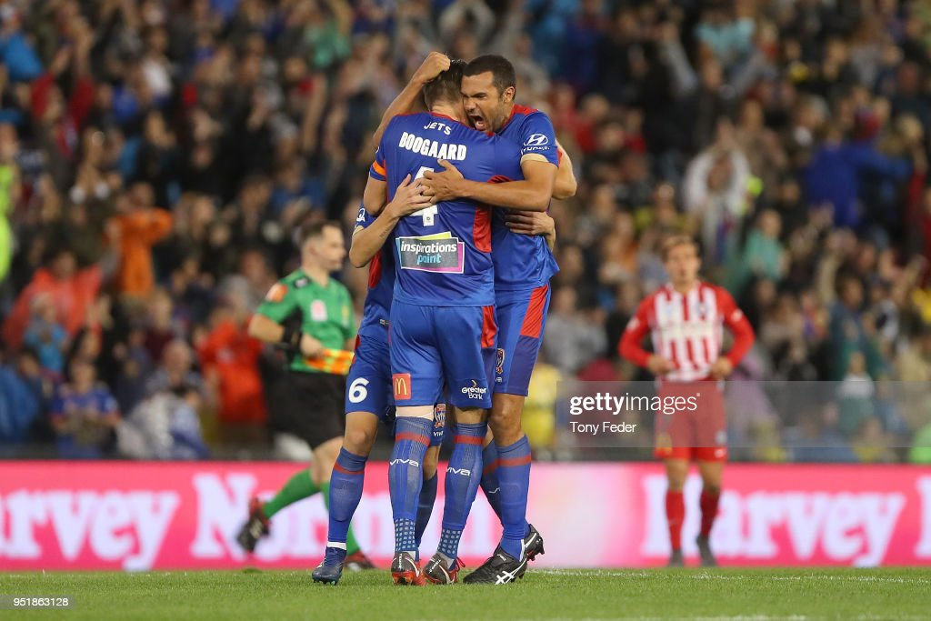 Nigel Boogaard and Nikolai Topor-Stanley of the Jets celebrate after defeating Melbourne City during the A-League Semi Final match between the Newcastle Jets and Melbourne City at McDonald Jones Stadium on April 27, 2018 in Newcastle, Australia.