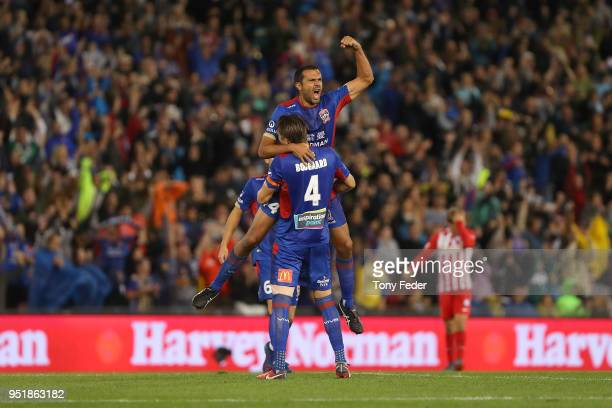 Nigel Boogaard and Nikolai Topor-Stanley of the Jets celebrate after defeating Melbourne City during the A-League Semi Final match between the...