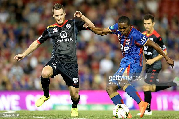 Nigel Boogaard of Adelaide contests the ball against Edson Montano of the Jets during the round 12 A-League match between the Newcastle Jets and...