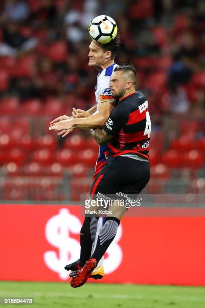 Nigel Boogaard of the Jets and Josh Risdon of the Wanderers compete for the ball in the air during the round 20 ALeague match between the Western...