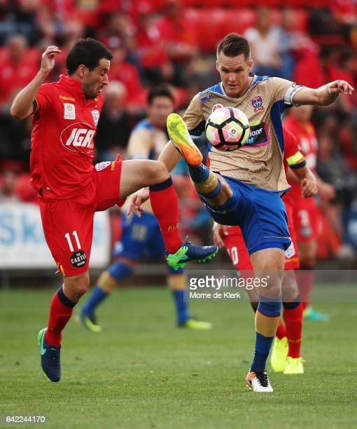Nigel Boogaard of the Jets attempts to clear the ball in front of Sergio Cirio of Adelaide United during the round 20 ALeague match between Adelaide...