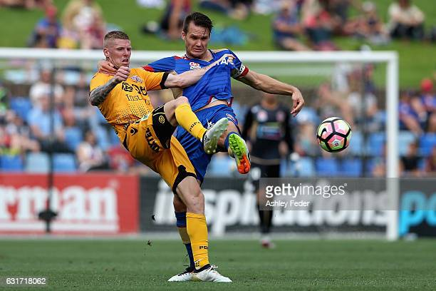Nigel Boogaard of the Jets contests the ball against Andrew Keogh of the Glory during the round 15 ALeague match between the Newcastle Jets and the...