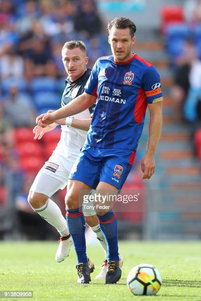 Nigel Boogaard of the Jets contests the ball with Besart Berisha of the Victory during the round 19 ALeague match between the Newcastle Jets and the...