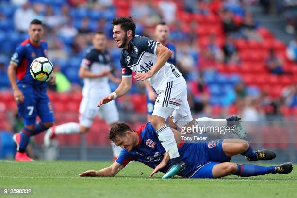 Nigel Boogaard of the Jets contests the ball with Christian Theoharous of the Victory during the round 19 ALeague match between the Newcastle Jets...