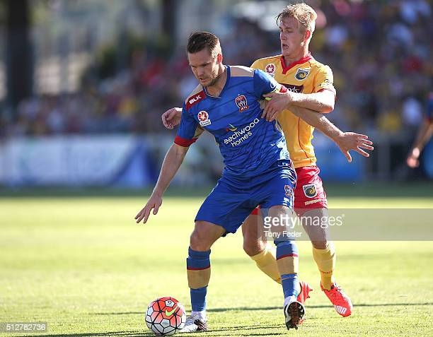 Nigel Boogaard of the Jets contests the ball with Josh Bingham of the Mariners during the round 21 A-League match between the Central Coast Mariners...