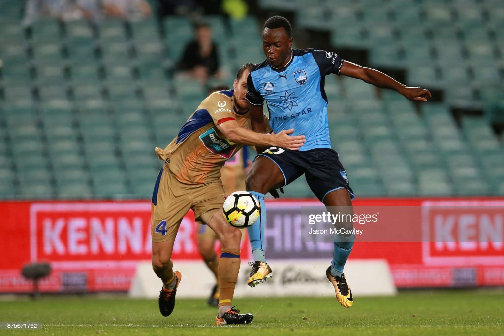 Nigel Boogaard of the Jets is challenged by Charles Lokoli Ngoy of Sydney during the round seven A-League match between Sydney FC and Newcastle Jets at Allianz Stadium on November 18, 2017 in Sydney, Australia.