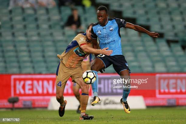 Nigel Boogaard of the Jets is challenged by Charles Lokoli Ngoy of Sydney during the round seven ALeague match between Sydney FC and Newcastle Jets...