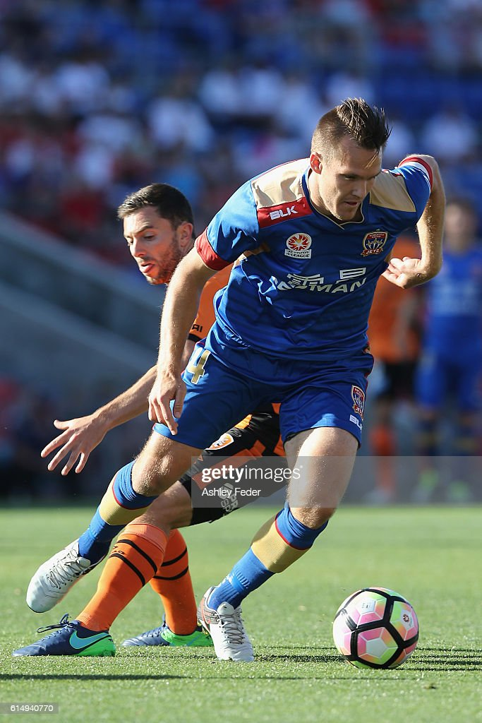 Nigel Boogaard of the Jets is contested by the Roar defence during the round two A-League match between the Newcastle Jets and the Brisbane Roar at Hunter Stadium on October 16, 2016 in Newcastle, Australia.