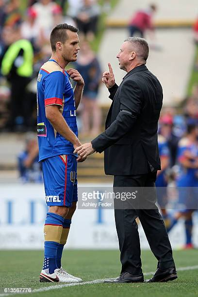 Nigel Boogaard of the Jets talks with coach Mark Jones during the round one ALeague match between the Newcastle Jets and Adelaide United at Hunter...