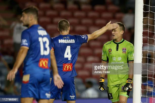 Nigel Boogaard of the Newcastle Jets congratulates Glen Moss on saving a penalty during the round 18 A-League match between the Newcastle Jets and...