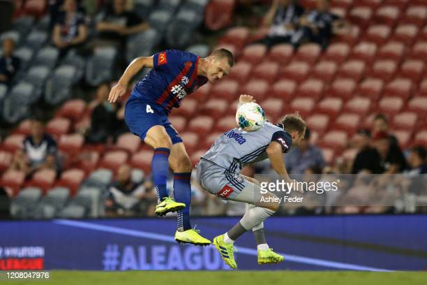 Nigel Boogaard of the Newcastle Jets heads the ball over Ola Toivonen of Melbourne Victory during the round 20 A-League match between the Newcastle...