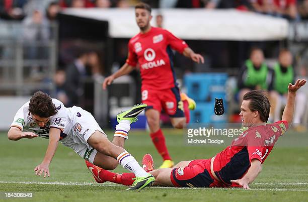 Nigel Boogaard of United gives away a penalty kick after this tackle on Daniel De Silva during the round one A-League match between Perth Glory and...