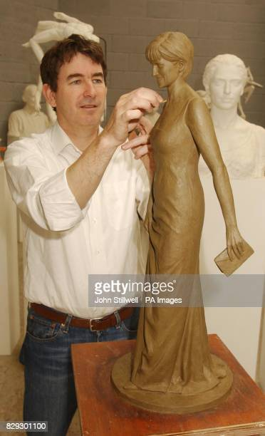 Nigel Boonham puts the finishing touches to a 30cm high clay model of the late Princess Diana of Wales which will become a 3 metre high bronze statue...