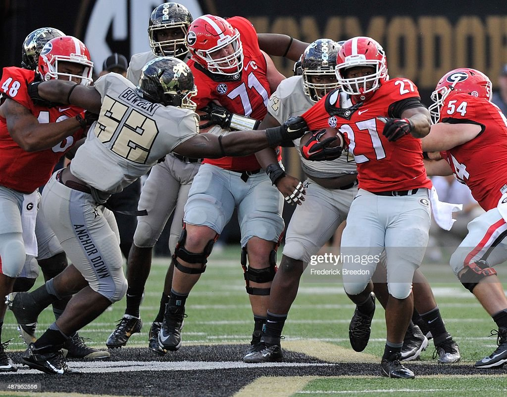 Nigel Bowden #52 of the Vanderbilt Commodores grabs the jersey of tailback Nick Chubb #27 of the Georgia Bulldogs during the second half at Vanderbilt Stadium on September 12, 2015 in Nashville, Tennessee.