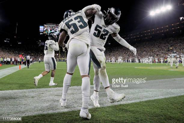 Nigel Bradham and Zach Brown of the Philadelphia Eagles celebrate after Bradham made an interception in the fourth quarter against the Green Bay...