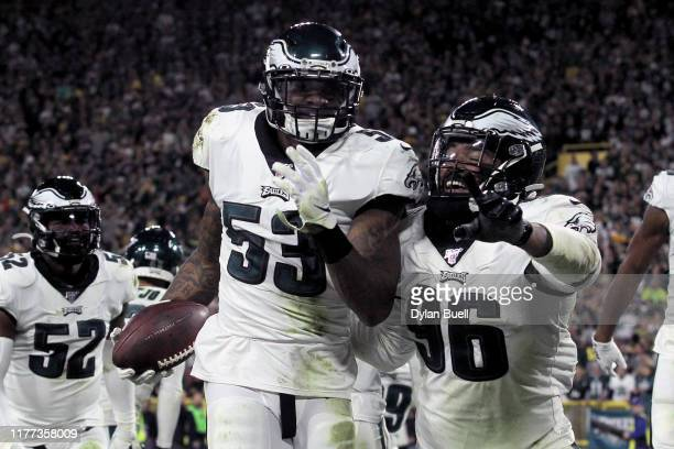 Nigel Bradham of the Philadelphia Eagles celebrates with teammates after making an interception in the fourth quarter against the Green Bay Packers...