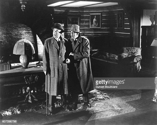 Nigel Bruce and Basil Rathbone on the set of 'The Scarlet Clow'