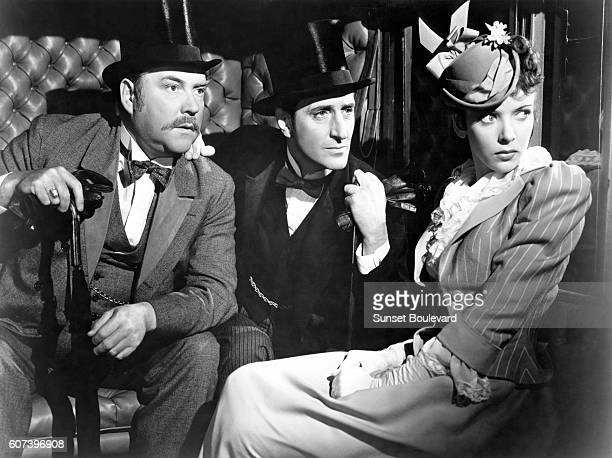 Nigel Bruce Basil Rathbone and Ida Lupino on the set of The Adventures of Sherlock Holmes directed by Alfred L Werker