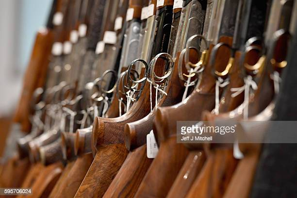 Nigel Budd and Emma Budd prepare sporting guns and rifles at Gleneagles Hotel on August 26 2016 in Aucterarder Scotland The annual auction of Fine...