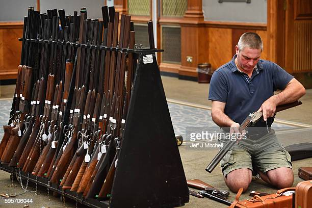 Nigel Budd prepares sporting guns and rifles at Gleneagles Hotel on August 26 2016 in Aucterarder Scotland The annual auction of Fine Modern and...