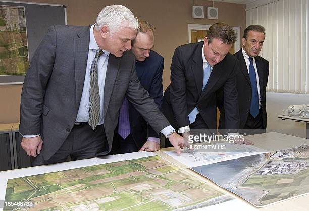 Nigel Cann site director of Hinkley Point C British Secretary for Energy and Climate Change Ed Davey British Prime Minister David Cameron and Henri...