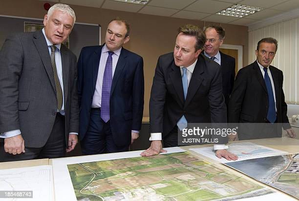 Nigel Cann site director of Hinkley Point C British Secretary for Energy and Climate Change Ed Davey British Prime Minister David Cameron Vincent de...