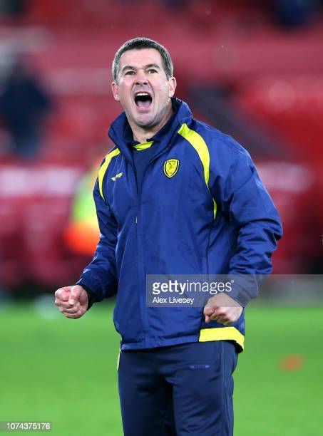 Nigel Clough, Manager of Burton Albion celebrates following his sides victory in the Carabao Cup Quarter Final match between Middlesbrough and Burton...
