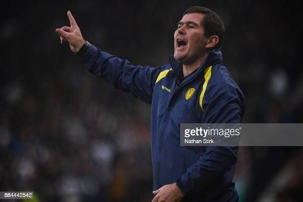 Nigel Clough manager of Burton Albion gives his players instructions during the Sky Bet Championship match between Derby County and Burton Albion at...