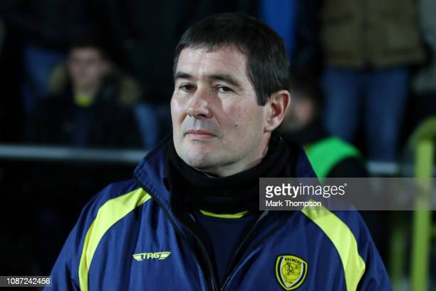 Nigel Clough Manager of Burton Albion looks on ahead of the Carabao Cup Semi Final Second Leg match between Burton Albion and Manchester City at...