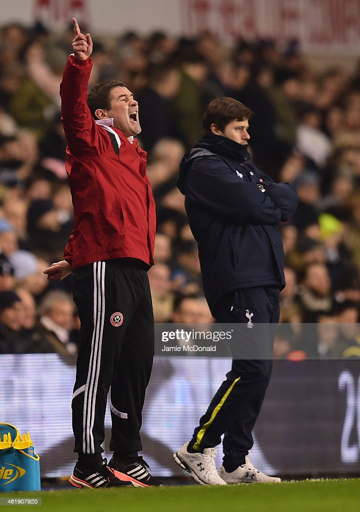 Nigel Clough, manager of Sheffield United and Manager Mauricio Pochettino of Spurs on the touchline during the Capital One Cup Semi-Final first leg match between Tottenham Hotspur and Sheffield United at White Hart Lane on January 21, 2015 in London, England.