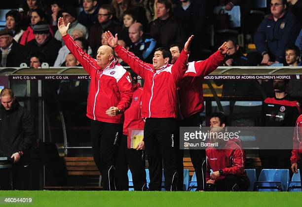 Nigel Clough manager of Sheffield United gestures with support staff during the Budweiser FA Cup third round match between Aston Villa and Sheffield...