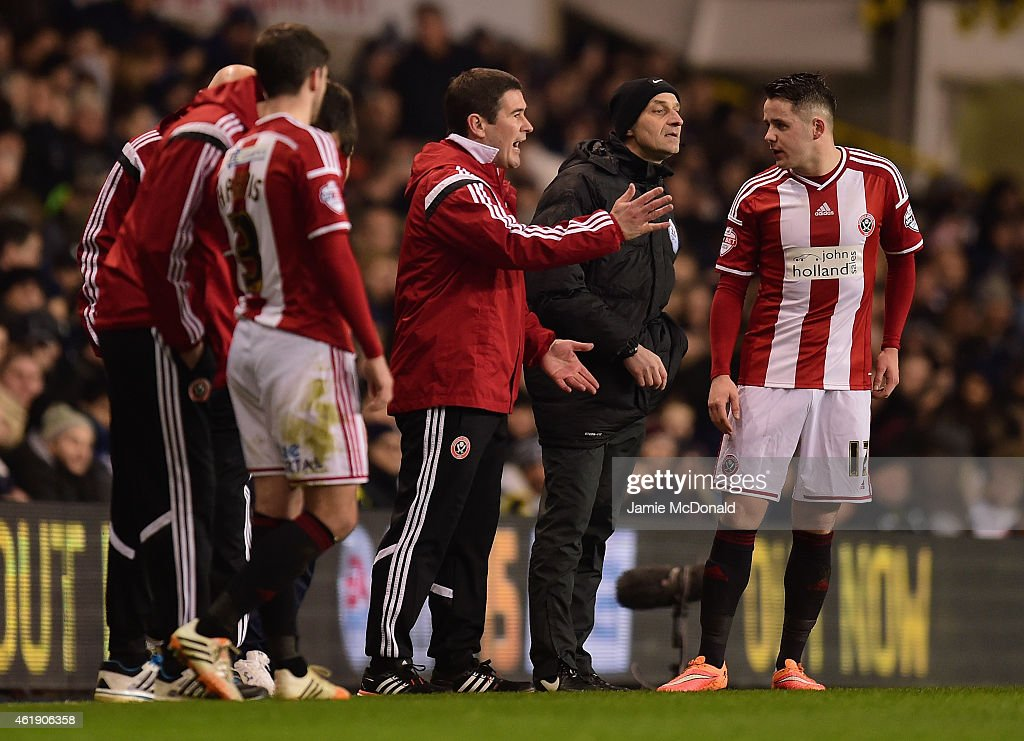 Nigel Clough, manager of Sheffield United speaks to Marc McNulty of Sheffield United (R) during the Capital One Cup Semi-Final first leg match between Tottenham Hotspur and Sheffield United at White Hart Lane on January 21, 2015 in London, England.