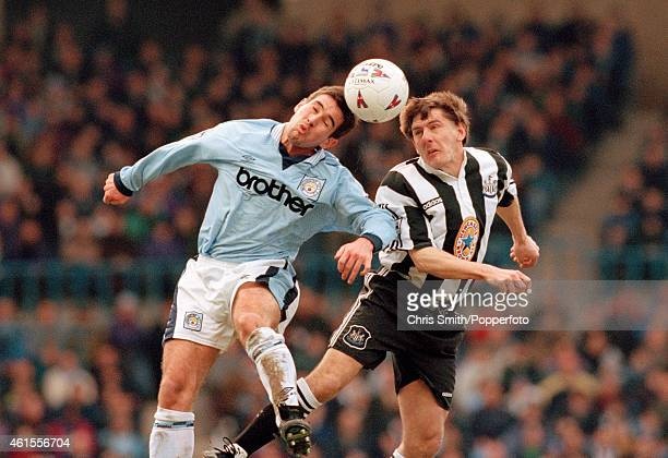 Nigel Clough of Manchester City and Peter Beardsley of Newcastle United head the ball during the FA Premier League match at Maine Road in Manchester...