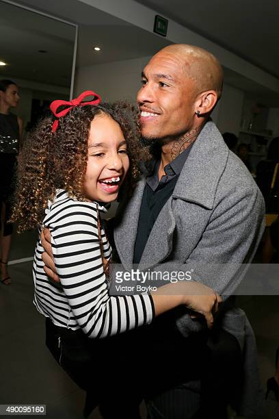 Nigel de Jong and daughter attend the Winonah cocktail party during the Milan Fashion Week Spring/Summer 2016 on September 25 2015 in Milan Italy
