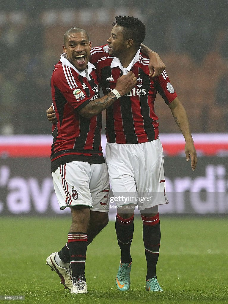 Nigel De Jong (L) and Robinho (R) of AC Milan celebrate a victory at the end of the Serie A match between AC Milan and Juventus FC at San Siro Stadium on November 25, 2012 in Milan, Italy.