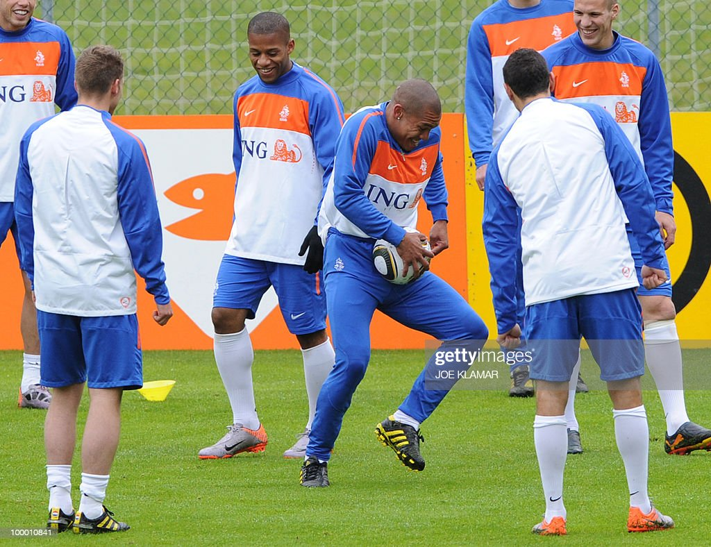 Nigel De Jong (C) jokes around with a football during the Dutch national football team's first practice at their training camp in Tyrolian village in Seefeld on May 20, 2010, prior to the FIFA World cup 2010 in South Africa.