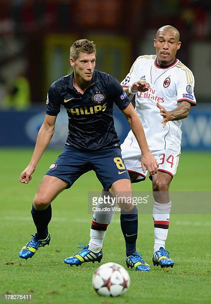 Nigel de Jong of AC Milan and Stijn Schaars of PSV compete for the ball during the UEFA Champions League Playoff Second Leg match between AC Milan v...