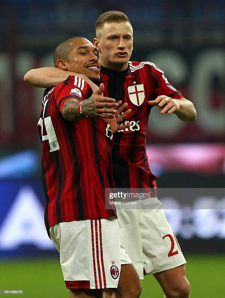 Nigel De Jong (L) of AC Milan celebrates with his team-mate Ignazio Abate (R) after scoring his goal during the TIM Cup match between AC Milan and US Sassuolo Calcio at Stadio Giuseppe Meazza on January 13, 2015 in Milan, Italy.
