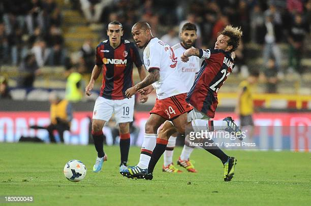 Nigel De Jong of AC Milan competes the ball with Alessandro Diamanti of Bologna FC during the Serie A match between Bologna and AC Milan at Stadio...