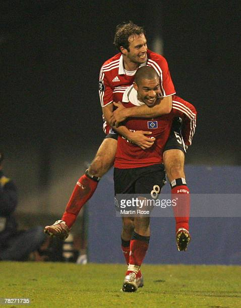 Nigel de Jong of Hamburg celebrates with team mate Joris Mathijsen after he scores the 1st goal for his team during the UEFA Cup Group D match...