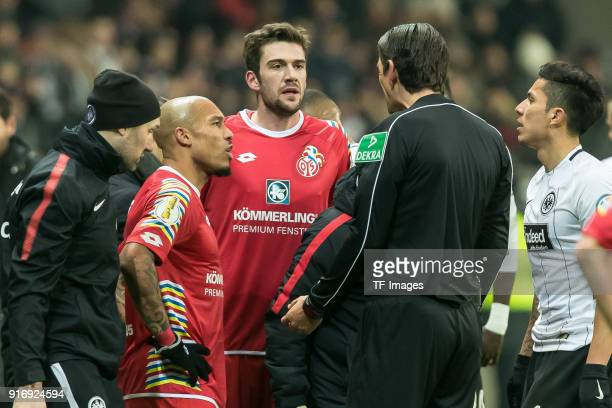 Nigel de Jong of Mainz Stefan Bell of Mainz and Deniz Aytekin speak with Referee Mittwoch during the DFB Cup match between Eintracht Frankfurt and 1...